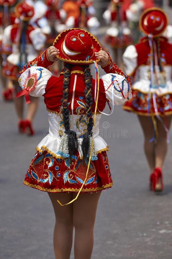 Caporales dancers at the carnival in Arica, Chile. Caporales dancer in ornate red and white costume performing at the annual Carnaval Andino con la Fuerza del royalty free stock images