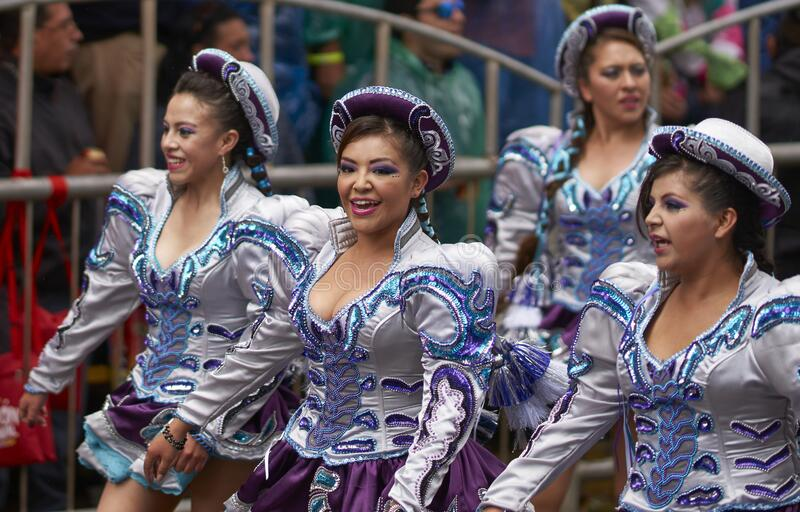 Caporales dancers parading at the Ouro Carnival in Bolivia royalty free stock photography