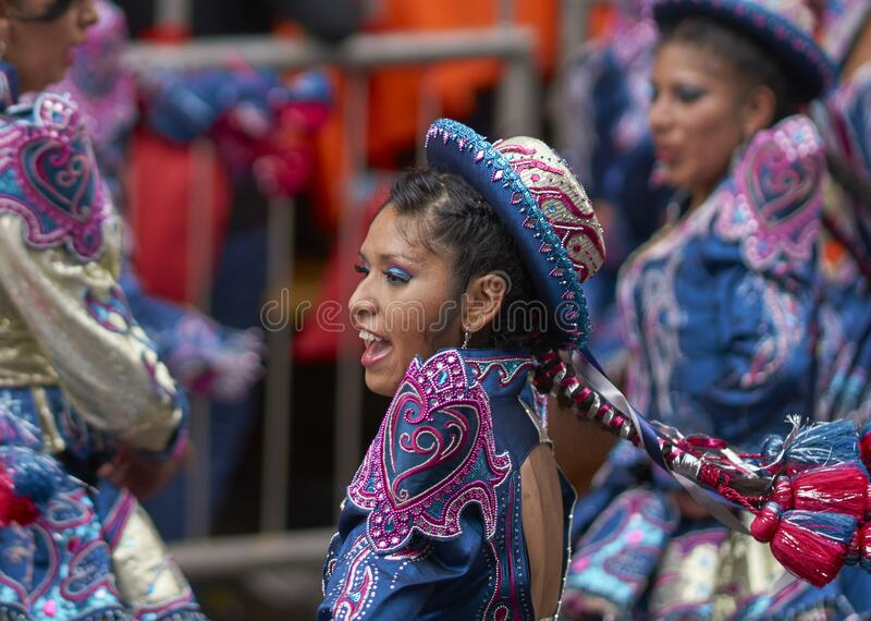 Caporales dancers parading at the Ouro Carnival in Bolivia royalty free stock photo