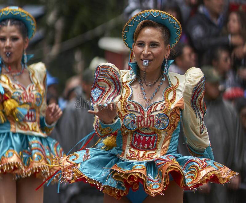 Caporales dancers parading at the Ouro Carnival in Bolivia royalty free stock image