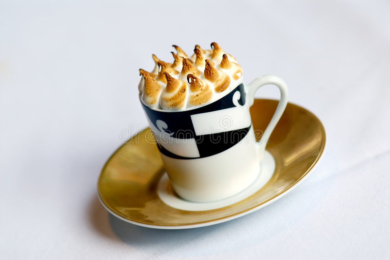 Cappaccino. Image of mugs of cappaccino on saucers royalty free stock photos