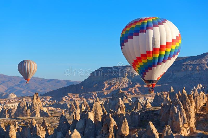Cappadocia. Balloons flying over rock landscape at Cappadocia Turkey stock images