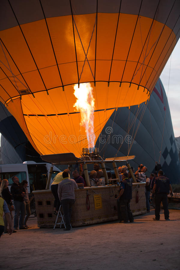 Cappadocia - preparations to the start of the balloon. At sunrise royalty free stock image