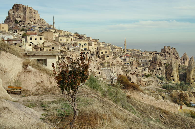 Hilly landscape. Goreme, Cappadocia - landmark attraction in Turkey. Hilly landscape. Volcanic formations converted into dwelling - Goreme, Cappadocia, landmark royalty free stock photography
