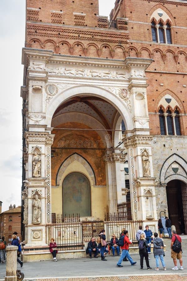 Cappella di Piazza on Piazza del Campo, square and historic center in Siena. Italy. Siena, Italy - October 02, 2018: Cappella di Piazza on Piazza del Campo stock photos