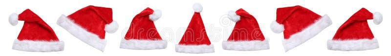Cappelli del cappello di Santa Claus sull'inverno di Natale isolati fotografia stock libera da diritti
