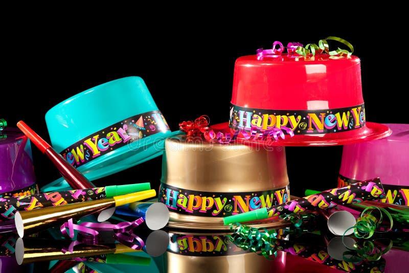 Cappelli del partito del Eve dei nuovi anni su priorità bassa nera fotografie stock