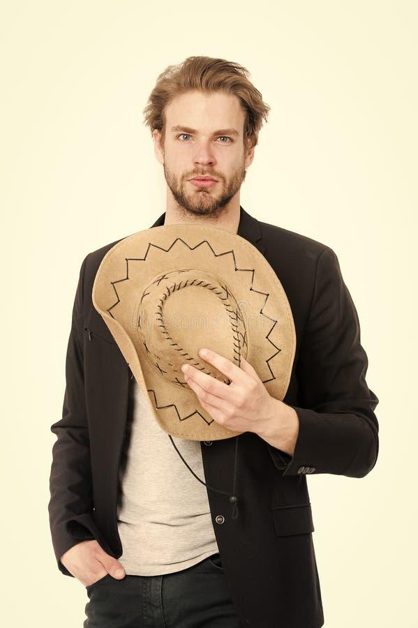 Cappello da cowboy d'uso del giovane o dell'uomo d'affari e rivestimento nero immagini stock