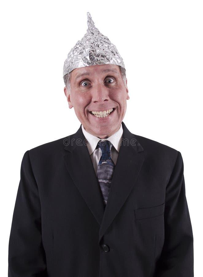 Cappello di alluminio dell'uomo d'affari divertente, controllo di mente fotografia stock