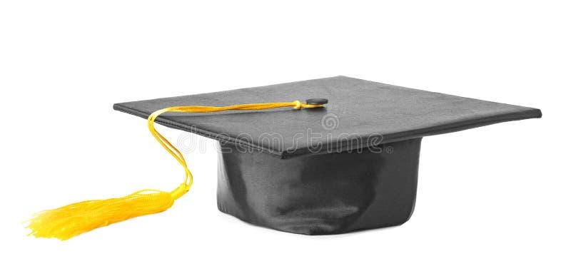 Cappello di graduazione con la nappa dell'oro fotografia stock