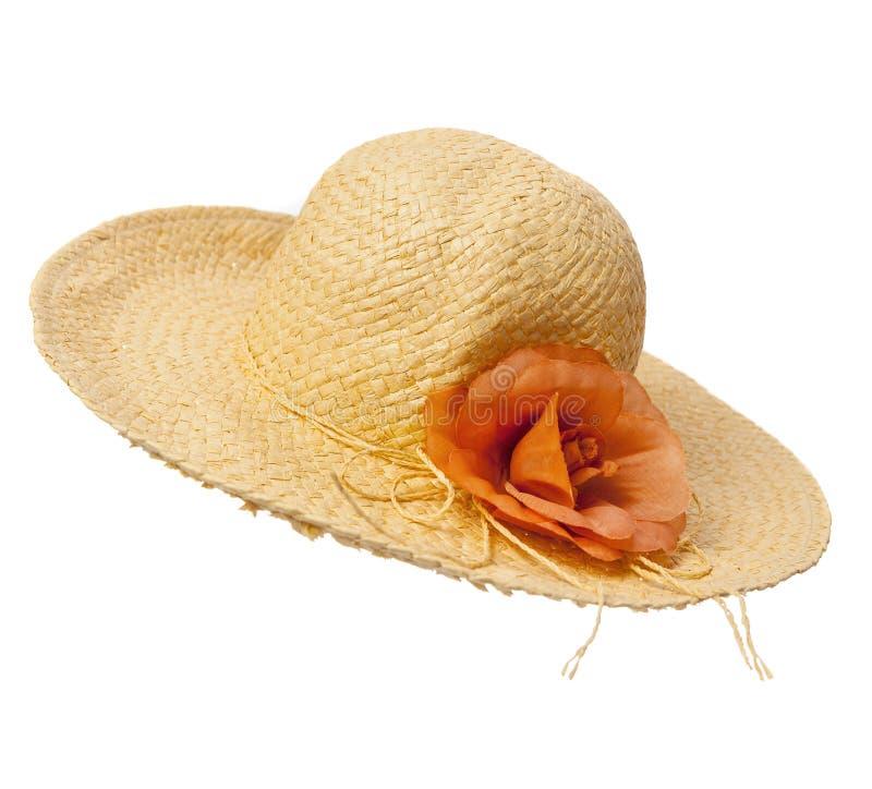 Cappello di paglia con il fiore immagini stock libere da diritti