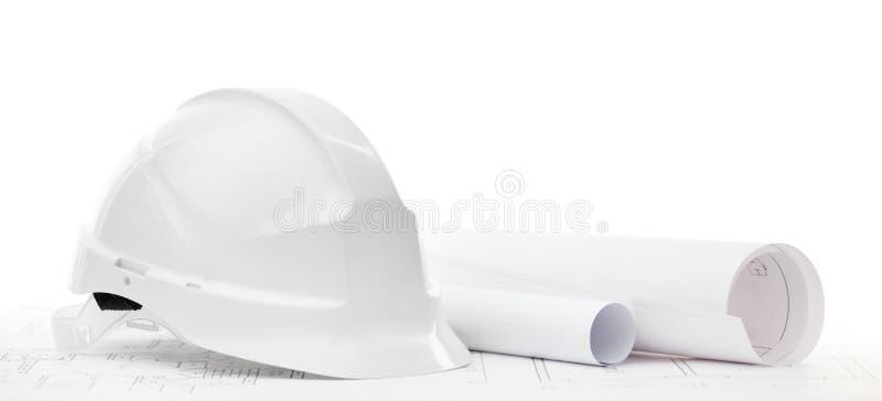 Cappello duro bianco vicino alle illustrazioni di funzionamento immagine stock