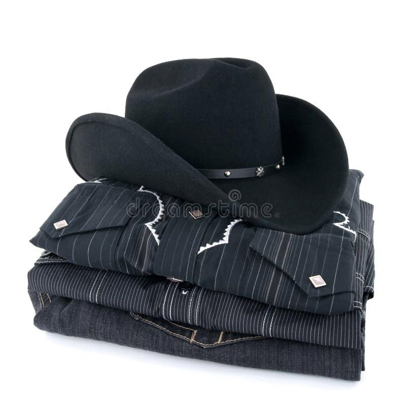 Cappello e vestiti di cowboy neri fotografia stock