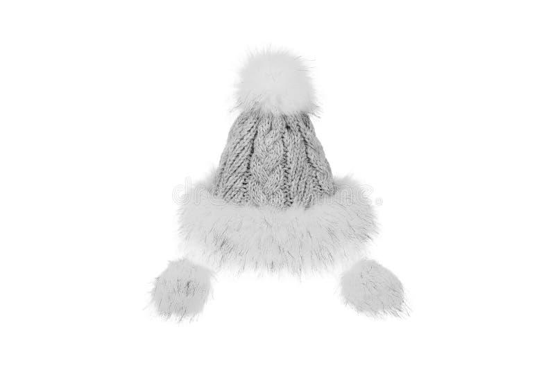 Cappello tricottato di inverno con pelliccia isolata su fondo bianco immagine stock