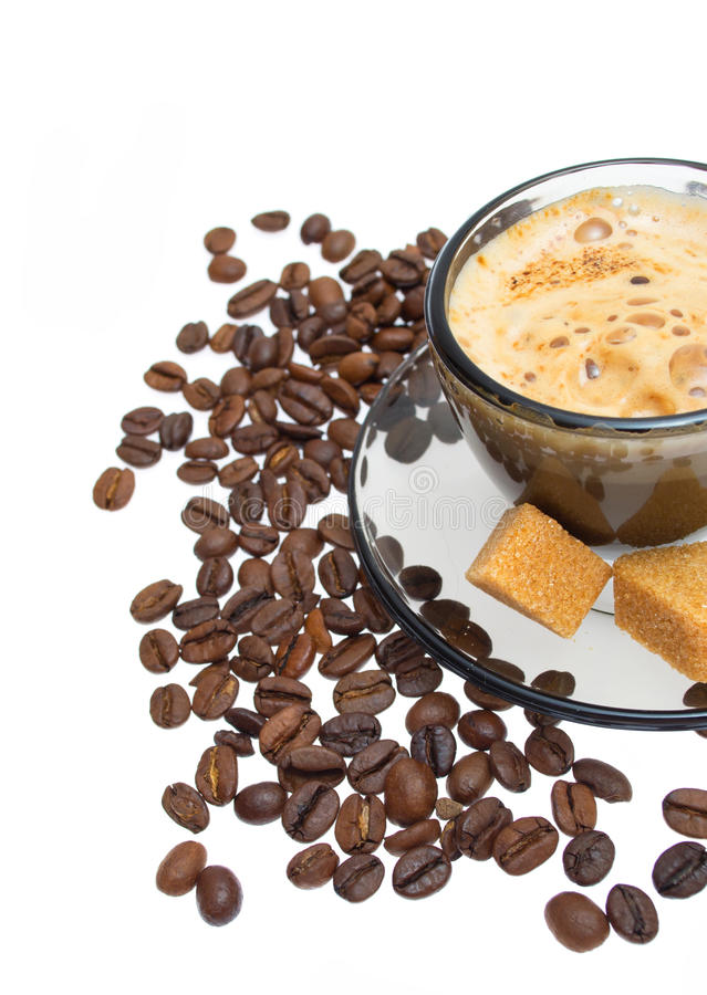 Cappuccino, brown sugar and coffee beans stock images