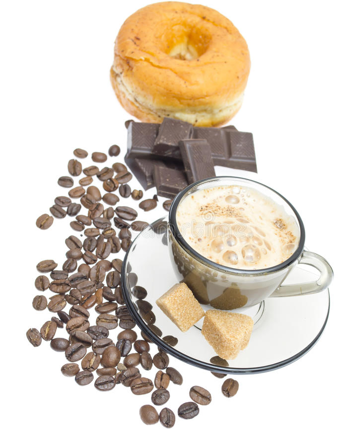 Cappuccino, brown sugar and coffee beans on white stock photo