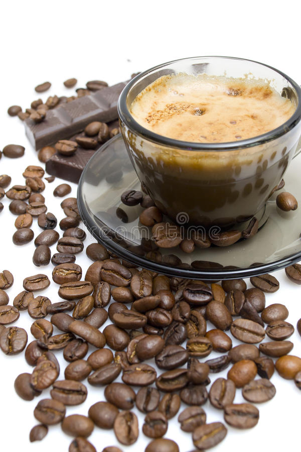 Cappuccino, brown sugar and coffee beans on white stock images