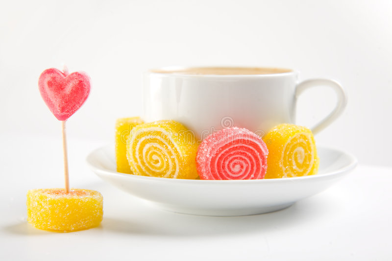 Cappuccino with candies royalty free stock photos