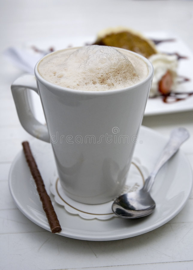 Cappuccino coffee. With dessert stock photography