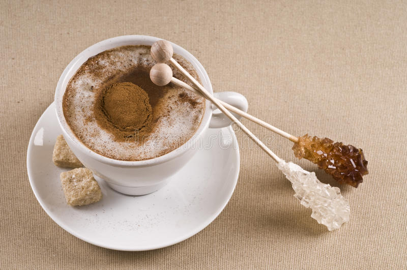 Cappuccino coffee cup with brown sugar stock image