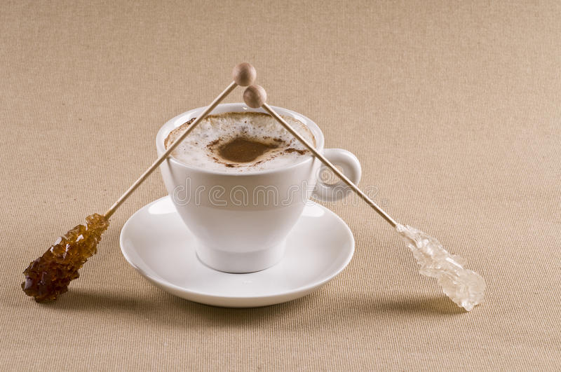 Cappuccino coffee cup with brown sugar royalty free stock photo