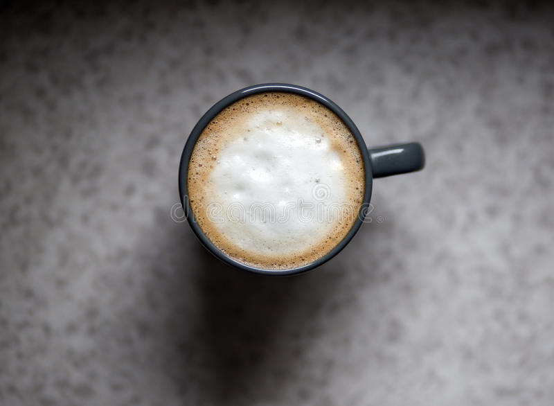 Cappuccino. Coffee cup seen from above with milk foam royalty free stock photo