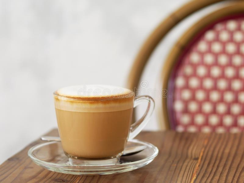 Cappuccino coffee with full fine bubble cream little cacao powder royalty free stock image