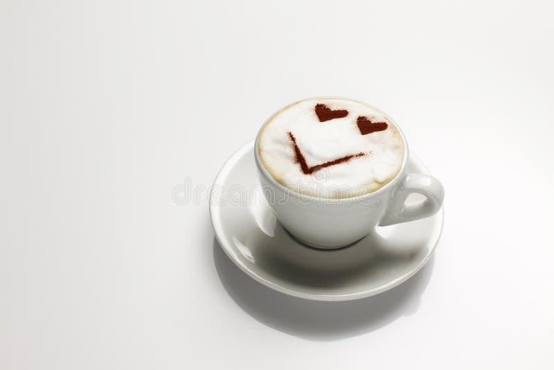 Cappuccino com a face no leite imagens de stock