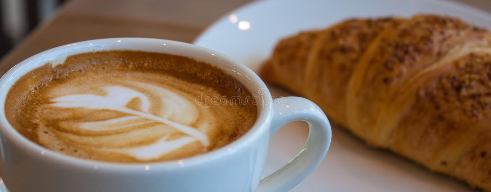 Cappuccino and croissant stock photo