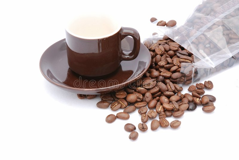 Cappuccino e feijões imagens de stock