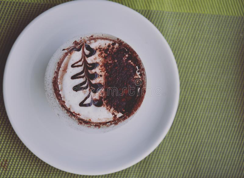 Cappuccino Espresso Cake on White Ceramic Plate royalty free stock image