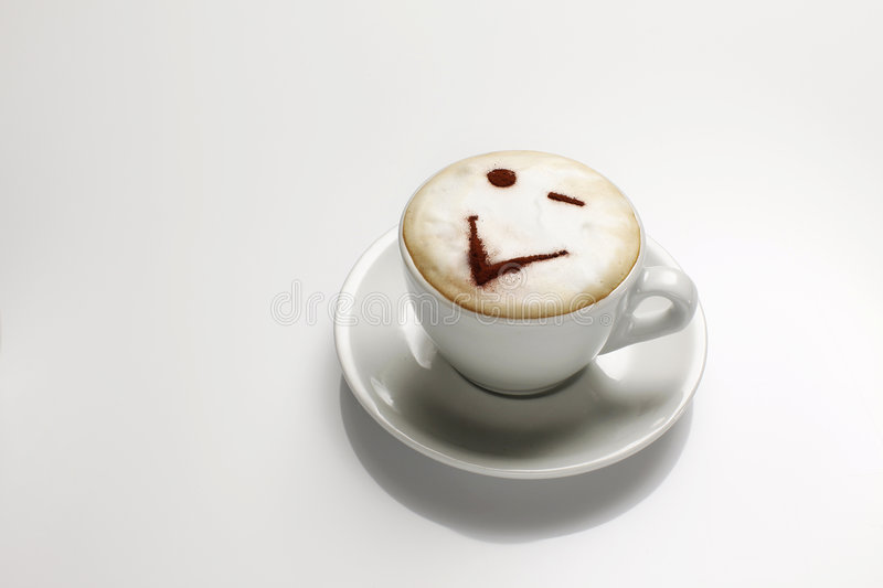 Cappuccino with a face stock image