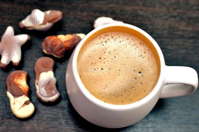 Cappuccino and gourmet Belgian chocolate royalty free stock images