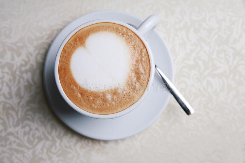 Cappuccino with heart design royalty free stock photos