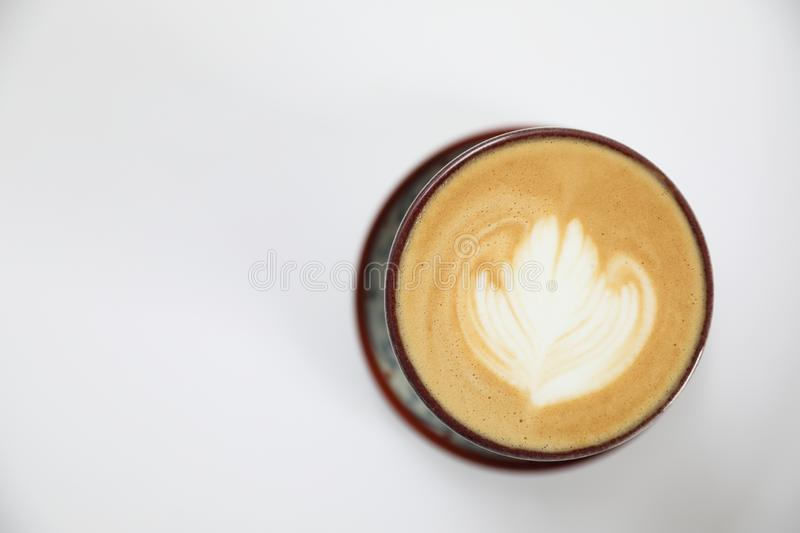 Cappuccino or Latte art coffee. In closeup royalty free stock photos