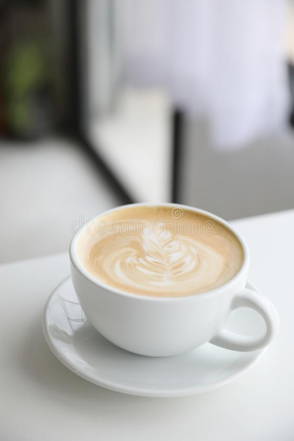 Cappuccino or Latte art coffee. On the table royalty free stock photos