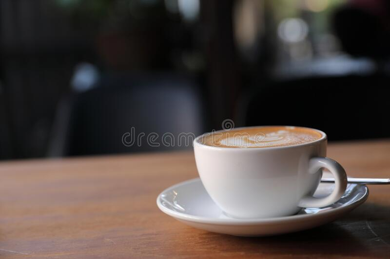 Cappuccino or Latte art coffee made from milk on the wood table in coffee shop. Cappuccino or Latte art coffee made from milk on the wood table stock photo