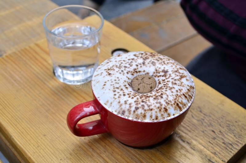 Cappuccino or latte coffee with a cookie. royalty free stock images