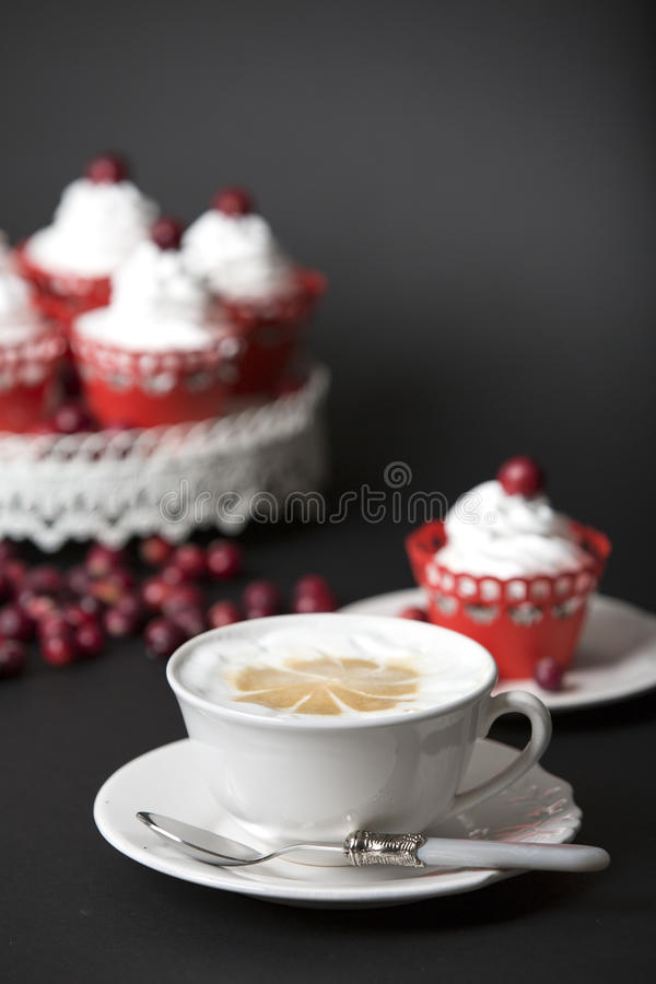 Cappuccino and muffin with cream and cranberries . royalty free stock images