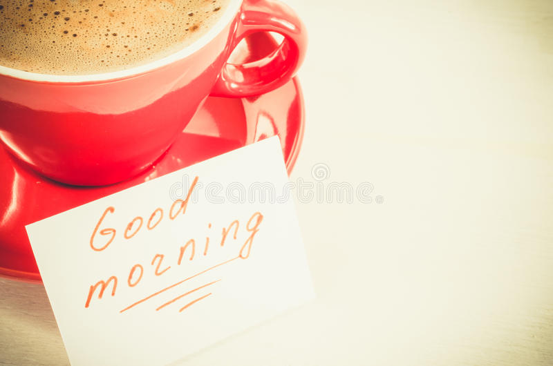 Cappuccino Mug and Notes Good Morning on Light Rustic Table. stock photos