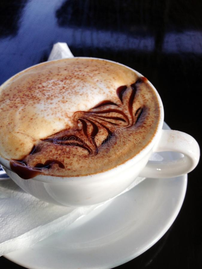 Cappuccino On White Ceramic Cup With Saucer stock photos