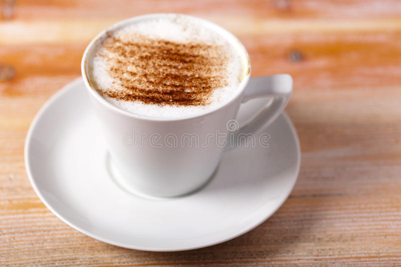 Cappuccino on a Wooden Table stock images