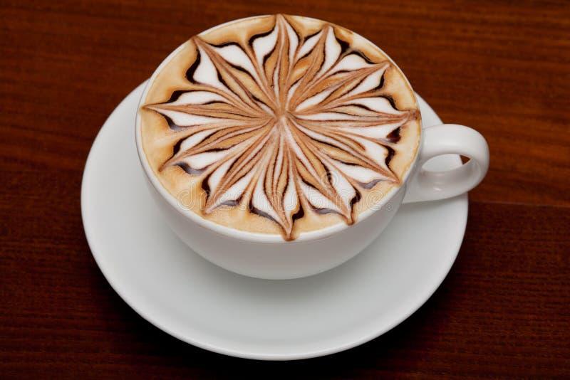 cappuccinokaffekopp royaltyfria bilder