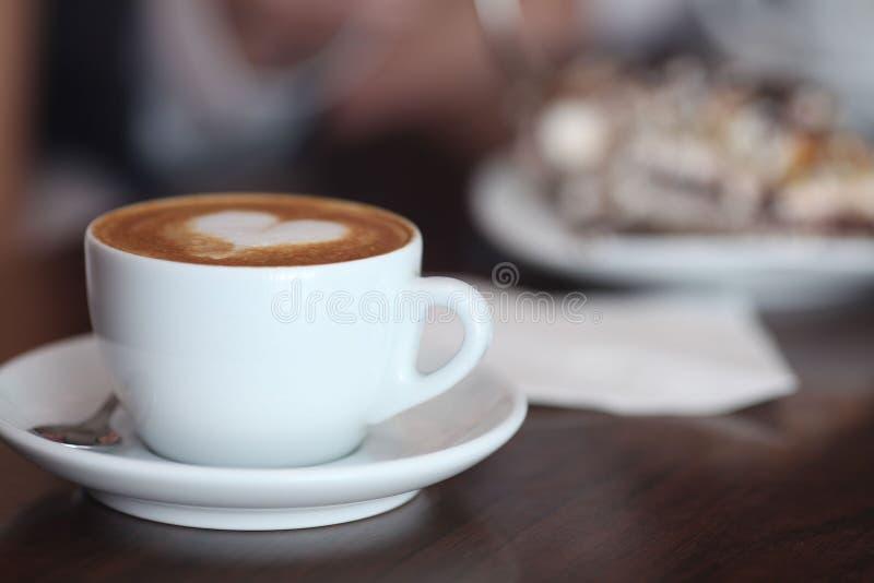 Cappuccinovänner royaltyfri fotografi