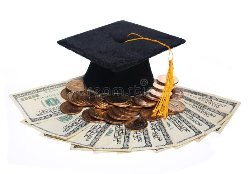 Cappuccio nero e soldi di graduazione isolati. fotografia stock