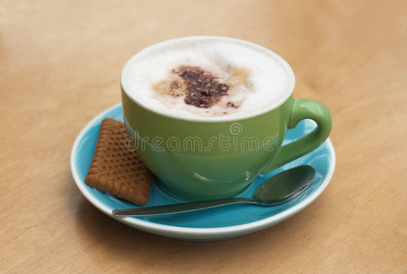 A cappucino coffee. A cappucino with trendy colors stock images