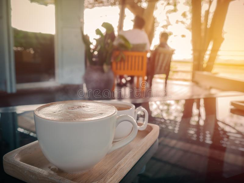 Cappucino cup with tea cup on blurred coffee shop or cafe restaurant.For create montage product display. Cappucino cup with tea cup on blurred coffee shop or stock image