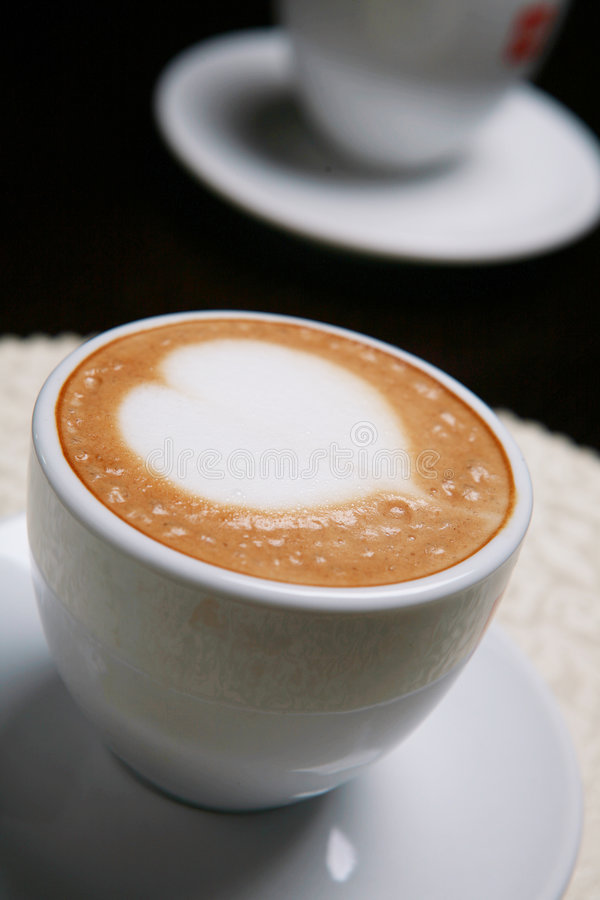 Cappucino with heart shape. Close up Cappucino with heart shape royalty free stock image