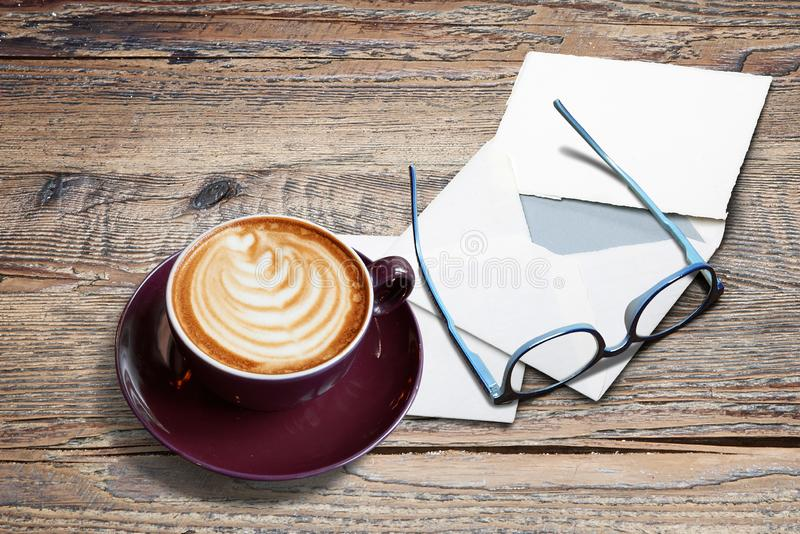 Cappucino with heart shape, letters, enveloppe and eyeglasses. On Textured Black marble table stock photo