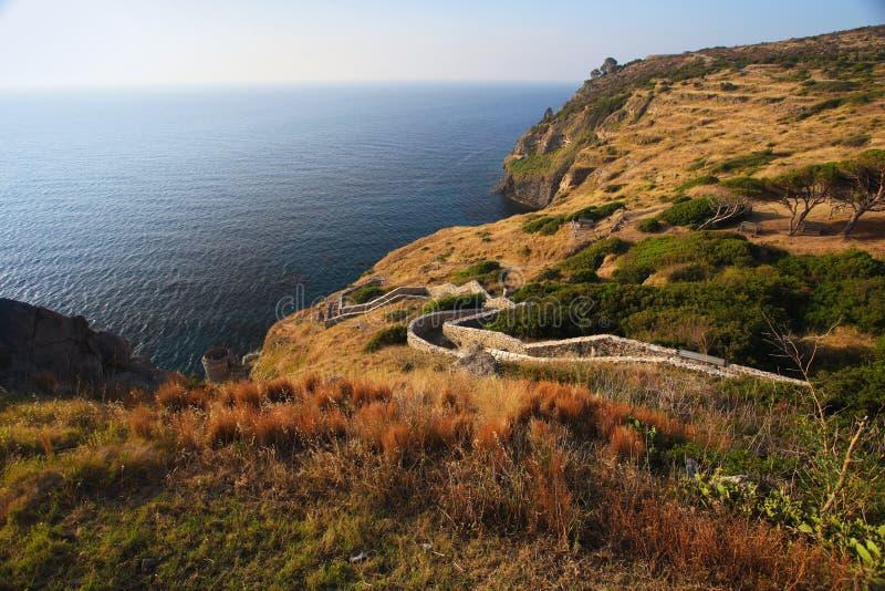 Capraia island shore and path to castle Elba, Tuscany, Italy, Eu. Rope stock images